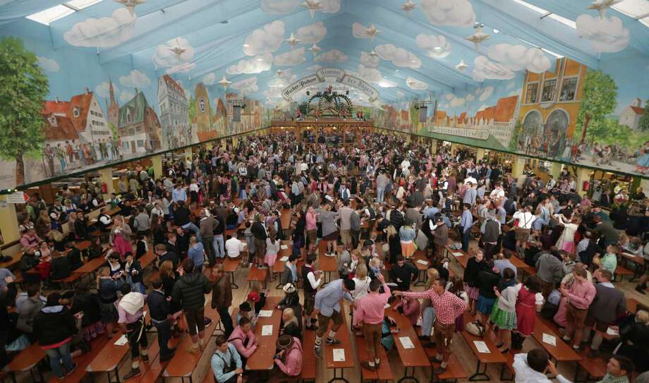 "People enter the ""Hacker Pschorr"" beer tent for the opening of the 180th Bavarian ""Oktoberfest"" beer festival in Munich, southern Germany, Saturday, Sept. 21, 2013. The world's largest beer festival, to be held from Sept. 21 to Oct. 6, 2013, is expected to attract more than six million guests from around the world. Photo: AP"