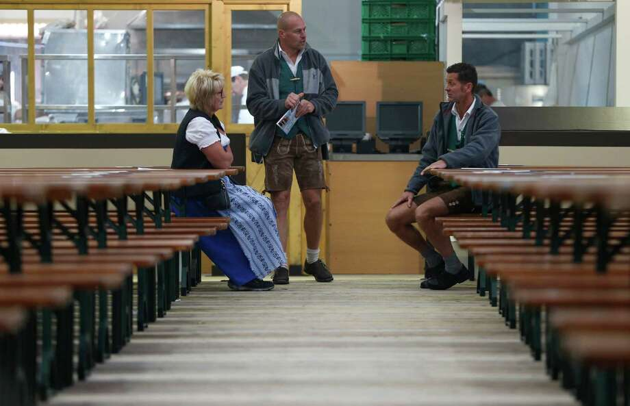 "A waitress and her collegues await the opening of the 180th Bavarian ""Oktoberfest"" beer festival in Munich, southern Germany, Saturday, Sept. 21, 2013. The world's largest beer festival, to be held from Sept. 21 to Oct. 6, 2013, is expected to attract more than six million guests from around the world. Photo: AP"