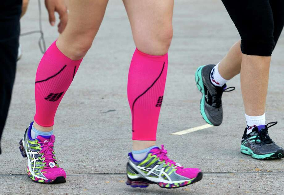 A runner wears pink socks as she runs the course during the 3rd Annual Running of the Bulls 5K Run/Walk at Reliant Park on Sunday, Sept. 22, 2013, in Houston. Over 5,500 people participated in the event with the proceeds benefiting the Houston Texans Foundation and Houston Methodist. Photo: J. Patric Schneider, For The Chronicle / © 2013 Houston Chronicle