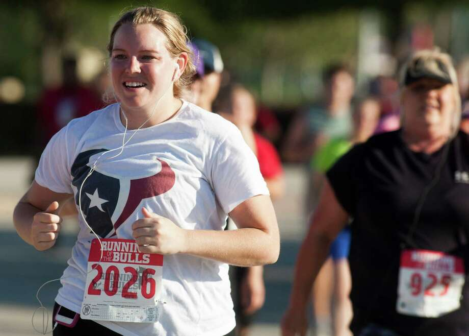 A runner runs the course during the 3rd Annual Running of the Bulls 5K Run/Walk at Reliant Park on Sunday, Sept. 22, 2013, in Houston. Over 5,500 people participated in the event with the proceeds benefiting the Houston Texans Foundation and Houston Methodist. Photo: J. Patric Schneider, For The Chronicle / © 2013 Houston Chronicle