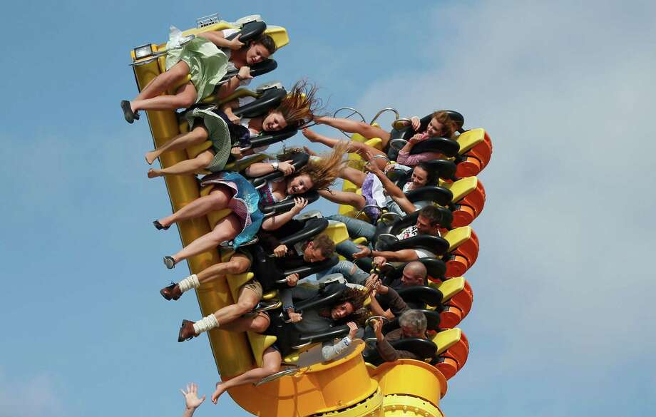 "Visitors enjoy a ride on a amusement park ride at the opening day of the Bavarian ""Oktoberfest"" beer festival in Munich, southern Germany, Saturday, Sept. 21, 2013. The world's largest beer festival, to be held from Sept. 21 to Oct. 6, 2013 will attract more than six million guests from around the world. Photo: AP"