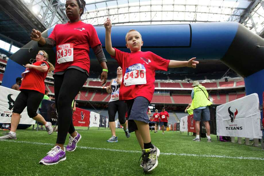 Luca Gasparini, 6, celebrates after he crosses the finish line during the 3rd Annual Running of the Bulls 5K Run/Walk at Reliant Park on Sunday, Sept. 22, 2013, in Houston. Over 5,500 people participated in the event with the proceeds benefiting the Houston Texans Foundation and Houston Methodist. Photo: J. Patric Schneider, For The Chronicle / © 2013 Houston Chronicle