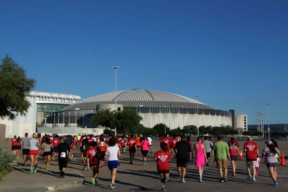 Runners run towards the Astrodome as they participate in the 3rd Annual Running of the Bulls 5K Run/Walk at Reliant Park on Sunday, Sept. 22, 2013, in Houston. Over 5,500 people participated in the event with the proceeds benefiting the Houston Texans Foundation and Houston Methodist. Photo: J. Patric Schneider, For The Chronicle / © 2013 Houston Chronicle