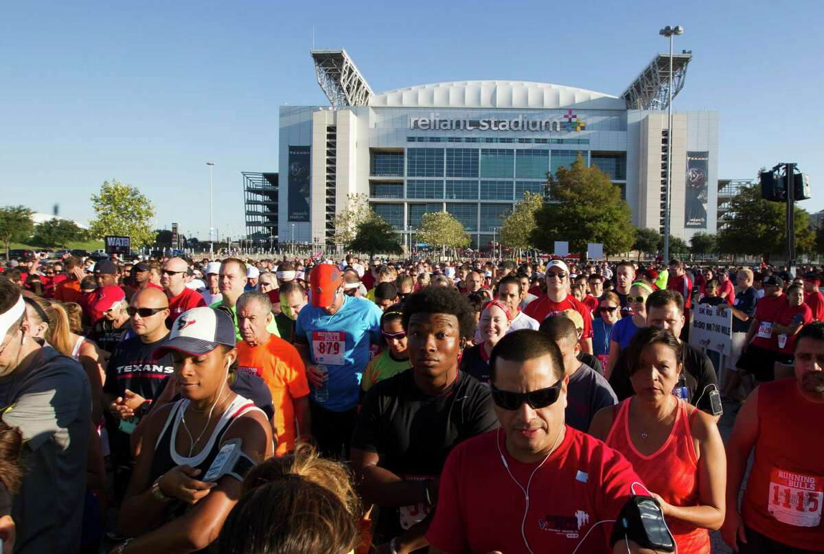 Over 5500 runners participated in the 3rd Annual Running of the Bulls 5K Run/Walk at Reliant Park on Sunday, Sept. 22, 2013, in Houston. Proceeds benefit The Houston Texans Foundation and Houston Methodist. The race concluded on the field at Reliant Stadium, with runners crossing through the bull tunnel that the Texans players run through on game days.