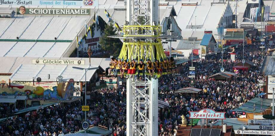"Visitors at the opening day at the 180th Bavarian ""Oktoberfest"" beer festival in Munich, southern Germany, Saturday, Sept. 21, 2013. The world's largest beer festival, to be held from Sept. 21 to Oct. 6, 2013 will attract more than six million guests from around the world. Photo: AP"