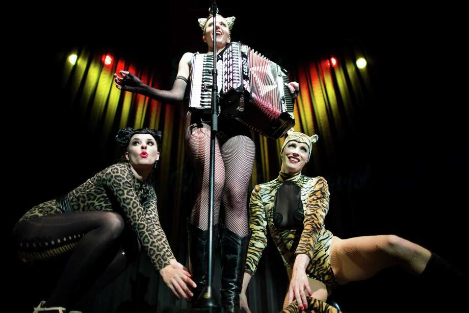 The Accordion Girl Natasha Enquist of Canada, center, and the stage kittens Mopsy Meyers, left, and Mama Tigra, right, perform during the Odd Night, the second show of the first international Berlin Burlesque Festival in Berlin on Friday, Sept. 20, 2013. The four-day festival including three different evening shows and different workshops hosts some 36 international burlesque artists. Photo: AP