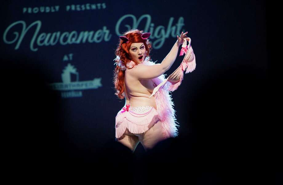 Burlesque artist Lady Francescca of Sweden performs during the Newcomer Night of the first international Berlin Burlesque Festival in Berlin, Germany, Thursday, Sept. 19, 2013. The four-day festival including three different evening shows and different workshops hosts some 36 international burlesque artists. Photo: AP