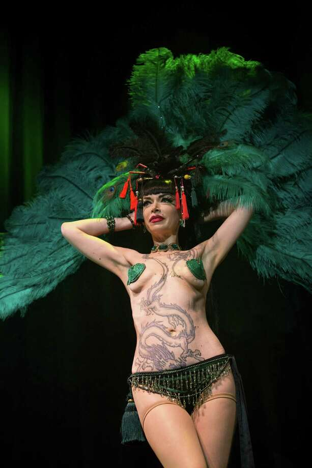 Burlesque artist Domino Barbeau of Canada performs during the Odd Night, the second show of the first international Berlin Burlesque Festival in Berlin, Germany, Friday, Sept. 20, 2013. The four-day festival including three different evening shows and different workshops hosts some 36 international burlesque artists. Photo: AP