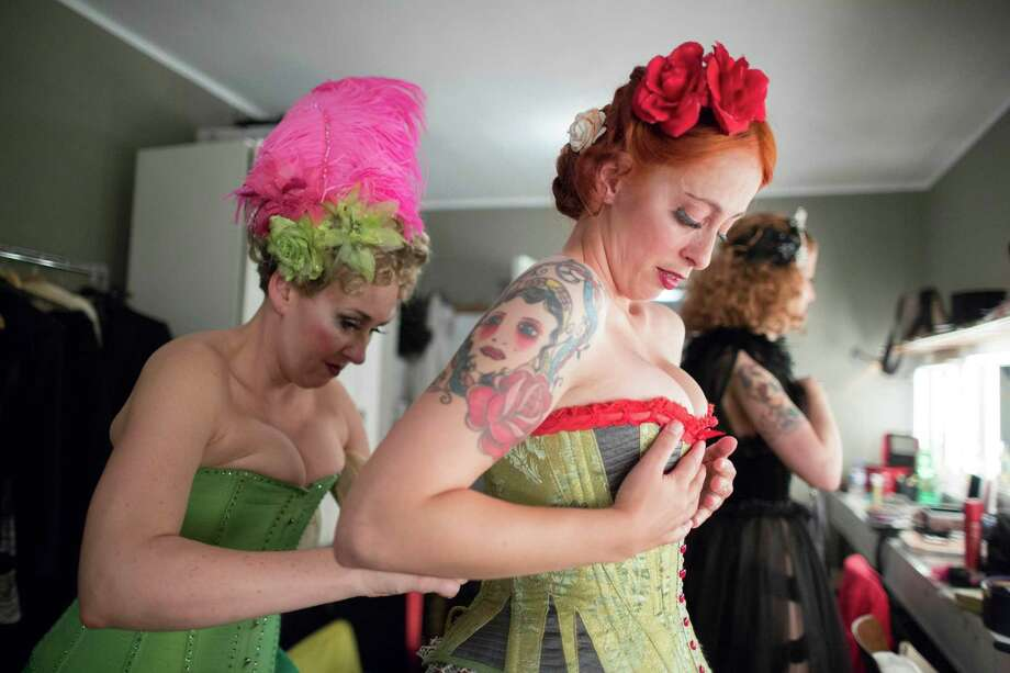 Burlesque artist and Berlin resident Champagne Sparkles of Canada, left, helps her colleague to put on her corsage backstage before performing at the Newcomer Night of the first international Berlin Burlesque Festival in Berlin, Germany, Thursday, Sept. 19, 2013. The four-day festival including three different evening shows and different workshops hosts some 36 international burlesque artists. Photo: AP