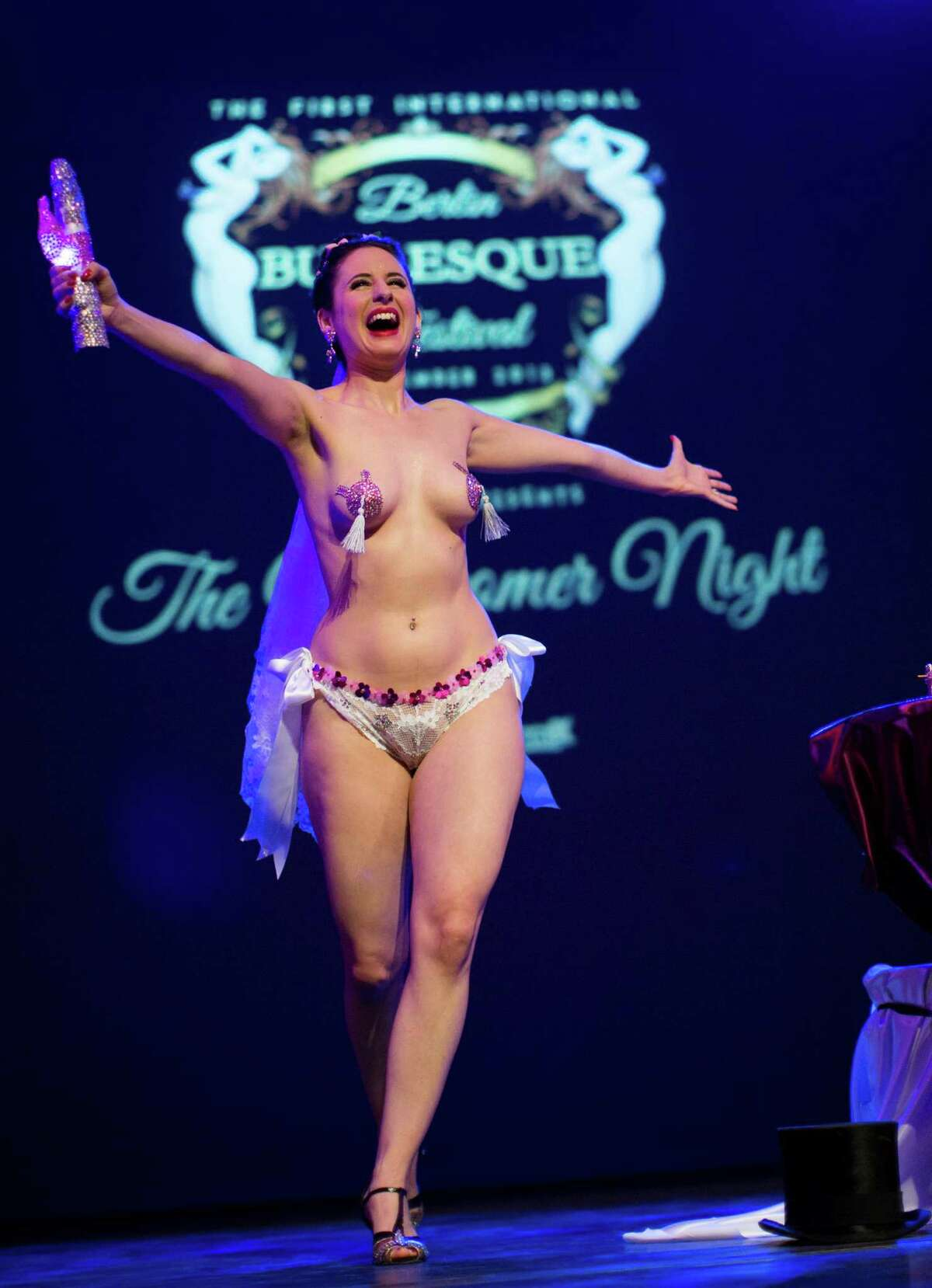 Burlesque artist Giddy Heights of Britain performs during the Newcomer Night of the first international Berlin Burlesque Festival in Berlin, Germany, Thursday, Sept. 19, 2013. The artists from overseas take part in the four-day festival which includes three different evening shows.