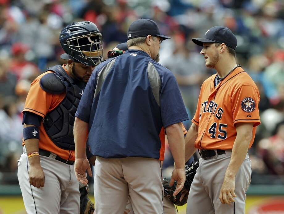 Starting pitcher Erik Bedard (45) talks with pitching coach Doug Brocail, center, as catcher Carlos Corporan, left, listens in in the fourth inning. Photo: Mark Duncan, Associated Press