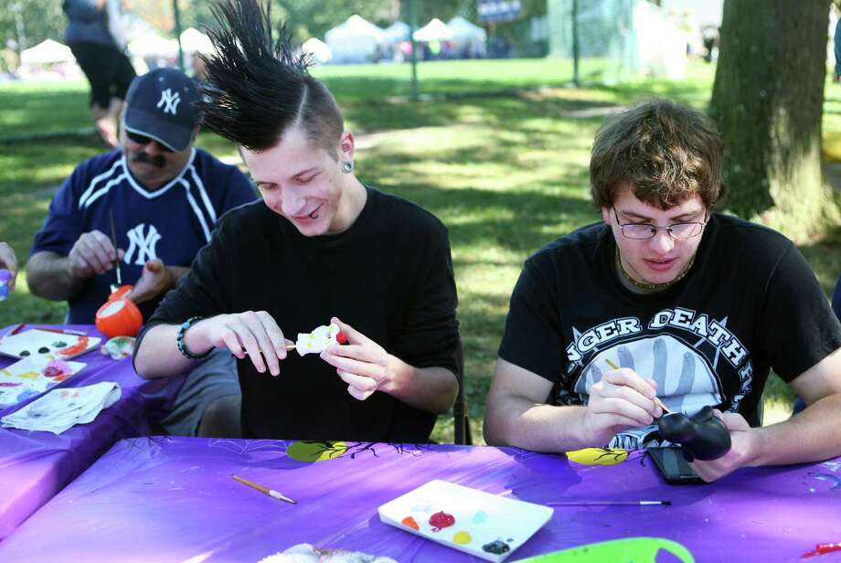Artists, from left, Don Akin, of Milford, Kyle Gliford, and Kyle Simmons, both 17 of Seymour, paint clay figures at the 48th Annual Seymour Pumpkin Festival at French Memorial Park on Sunday, Sept. 22, 2013. Photo: BK Angeletti, B.K. Angeletti / Connecticut Post freelance B.K. Angeletti