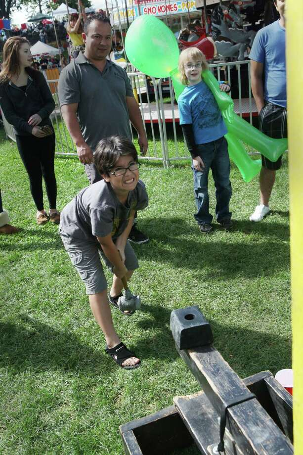 Jeffrey Benevides, 9, of Ansonia, bangs a bell for a large alien prize at the 48th Annual Seymour Pumpkin Festival at French Memorial Park on Sunday, Sept. 22, 2013. Photo: BK Angeletti, B.K. Angeletti / Connecticut Post freelance B.K. Angeletti