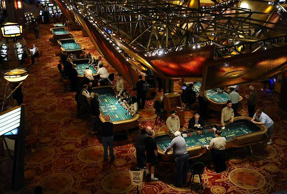 Gaming resorts including Mohegan Sun in Uncasville, Conn., keep watch on suspect players who can hit multiple casinos in a matter of days or even hours. Photo: Jessica Hill, Associated Press