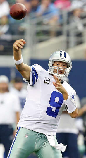 Dallas Cowboys' Tony Romo passes against the St. Louis Rams during second half action Sunday Sept. 2