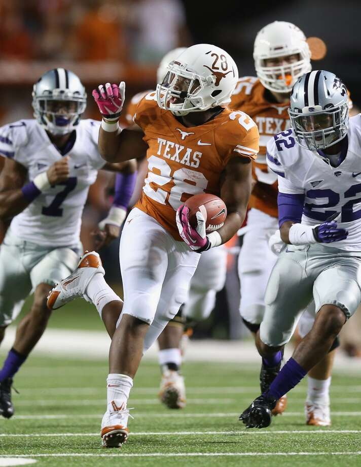 Texas 31, Kansas State 21Record: 2-2  Malcolm Brown breaks free for a run during the second half. Photo: Ronald Martinez, Getty Images
