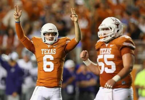 Case McCoy, left, and Dominic Espinosa celebrate a touchdown. Photo: Ronald Martinez, Getty Images