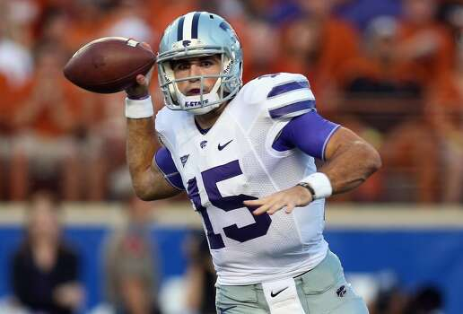 Kansas State quarterback Jake Waters looks to throw during the first half. Photo: Ronald Martinez, Getty Images