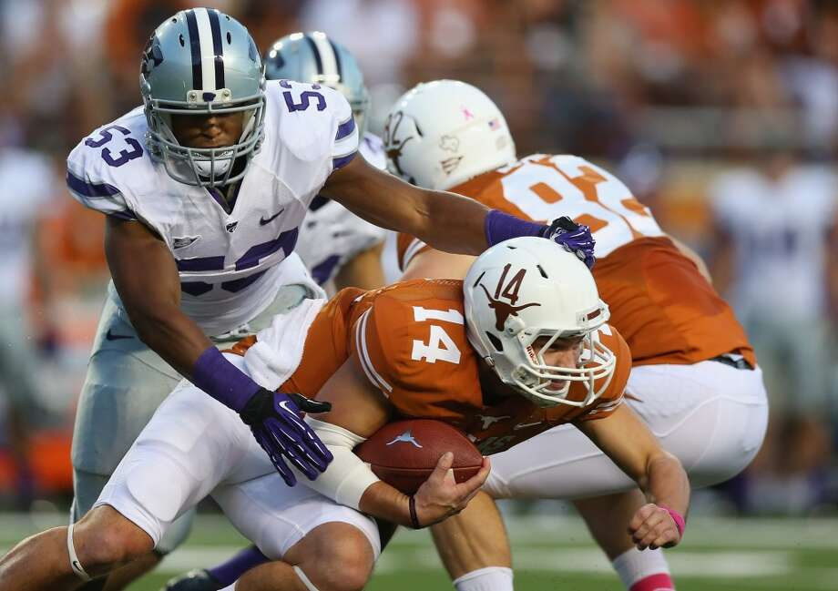 David Ash is tackled by Blake Slaughter during the first half of the Texas vs. Kansas State game on Sept. 21, 2013. Photo: Ronald Martinez, Getty Images