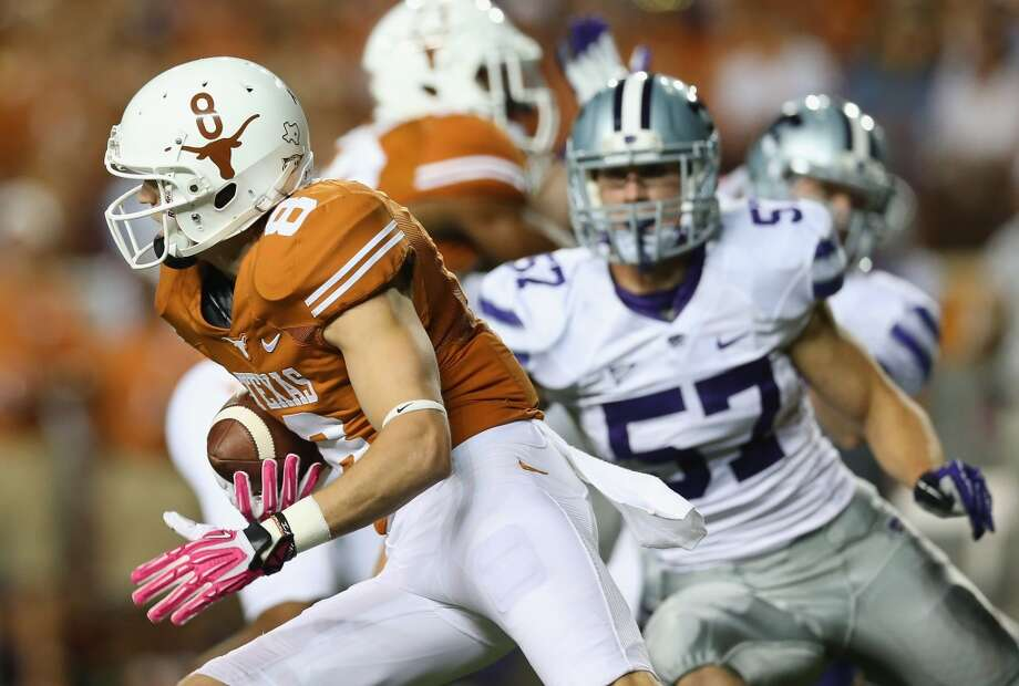 Jaxon Shipley runs with the ball during the first half. Photo: Ronald Martinez, Getty Images
