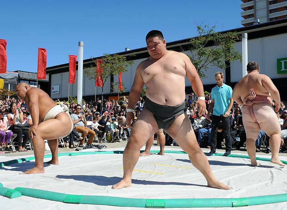 Sumo wrestlers, including U.S. Sumo bronze medalist Baatartsogt Jileekhuu of Mongolia, prepare for the show. Photo: Susana Bates, Special To The Chronicle