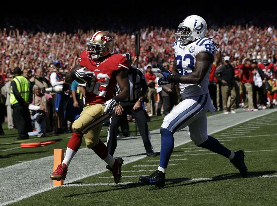 San Francisco 49ers running back Kendall Hunter (32) makes a 13-yard touchdown run as Indianapolis Colts outside linebacker Erik Walden (93) attempts to stop him in the first half an NFL football game in San Francisco, Sunday, Sept. 22, 2013. (AP Photo/Marcio Jose Sanchez) Photo: Associated Press