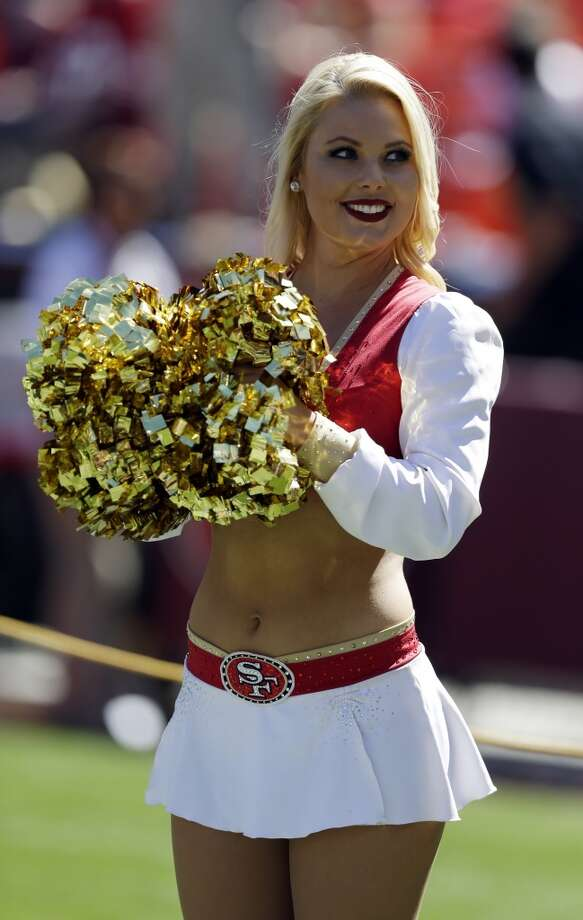 A San Francisco 49ers Gold Rush cheerleader performs during an NFL football game against the Indianapolis Colts on Sept. 22, 2013. Photo: Marcio Jose Sanchez, Associated Press