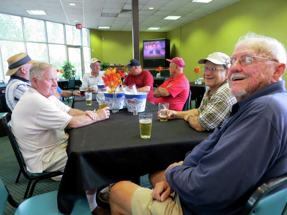 These old timers relaxing after golfing Thursday 9-19-13 morning at Landa Park Golf Course were unanimous in their opposition to New Braunfels City Council plans to spend millions to overhaul the course. They want more modest improvements made so green fees won't be raised the $10-$20 now anticipated. Photo: Zeke MacCormack