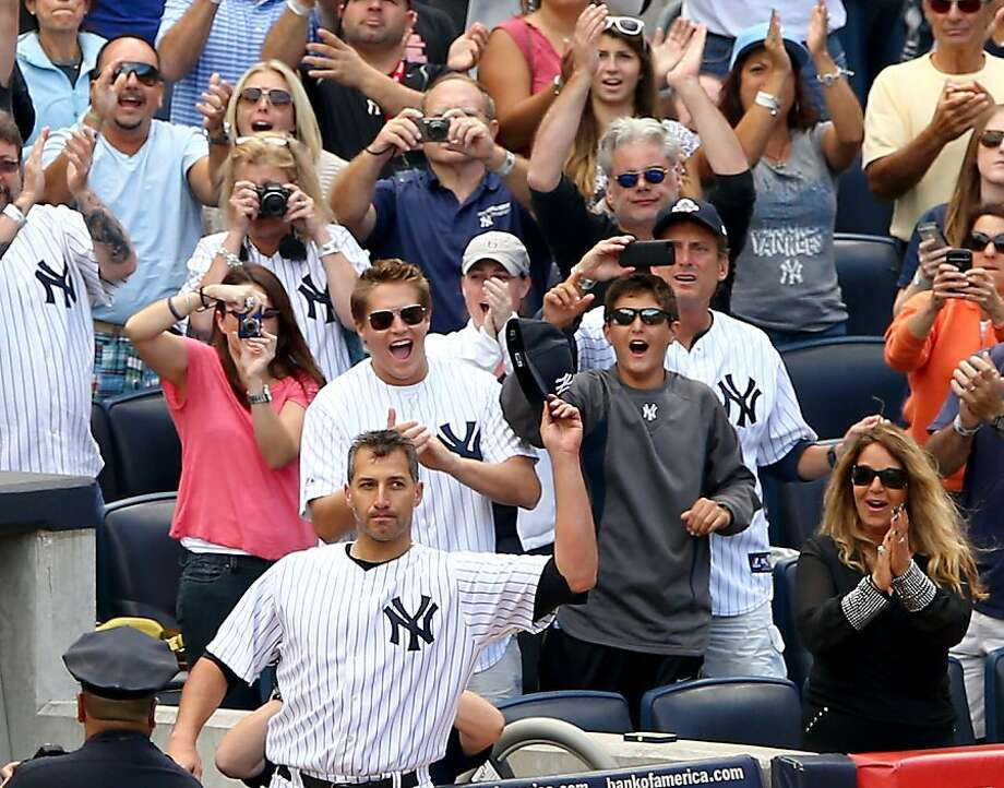 Yankees left-hander Andy Pettitte salutes the fans during a curtain call after he was pulled from his final home start in the eighth inning. Photo: Elsa, Getty Images