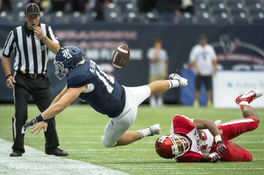 Rice quarterback Taylor McHargue fumbles the ball as he is knocked out of bounds by Houston defensive back Zachary McMillian. Photo: Smiley N. Pool, Houston Chronicle