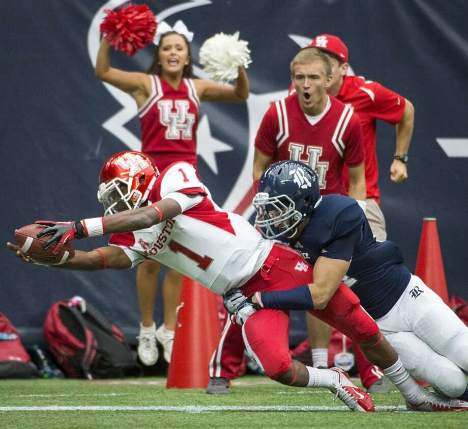 Houston quarterback Greg Ward (1) comes up short of the touchdown as he dives toward the end zone as Rice safety Paul Porras defends. Photo: Smiley N. Pool, Houston Chronicle