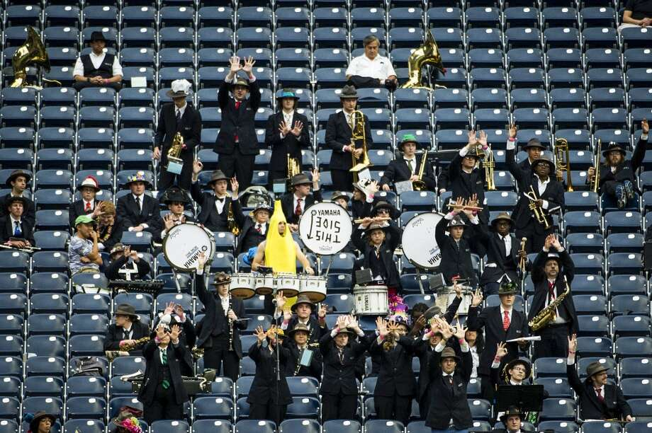 The Rice University Marching Owl Band cheers for their team against Houston. Photo: Smiley N. Pool, Houston Chronicle