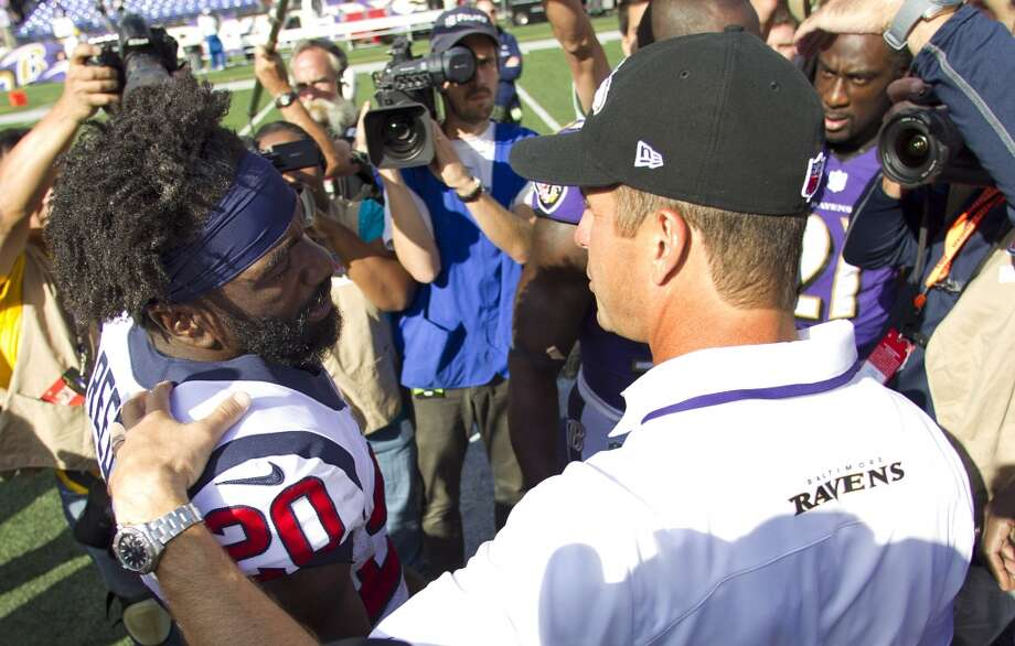 Ravens coach John Harbaugh speaks with Texans safety Ed Reed after the game. Photo: Brett Coomer, Houston Chronicle