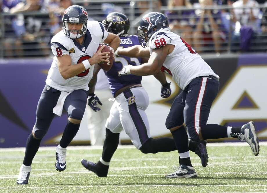 Ravens defenders chase Texans quarterback Matt Schaub out of the pocket. Photo: Brett Coomer, Houston Chronicle