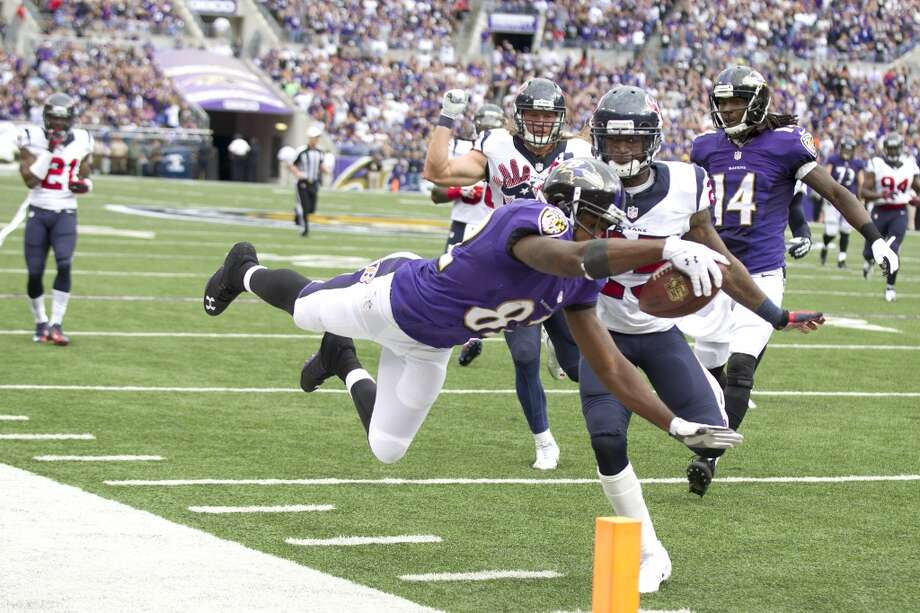 Ravens receiver Torrey Smith dives for the endzone against the Texans. Photo: Brett Coomer, Houston Chronicle