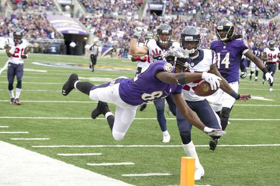 Ravens receiver Torrey Smith dives for the endzone against the Texans.