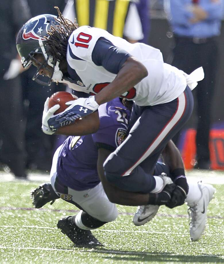 Texans receiver DeAndre Hopkins is brought down after making a catch. Photo: Brett Coomer, Houston Chronicle