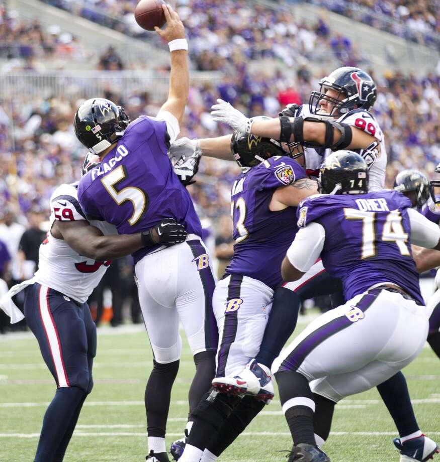Ravens quarterback Joe Flacco faces pressure from the Texans' defense. Photo: Brett Coomer, Houston Chronicle