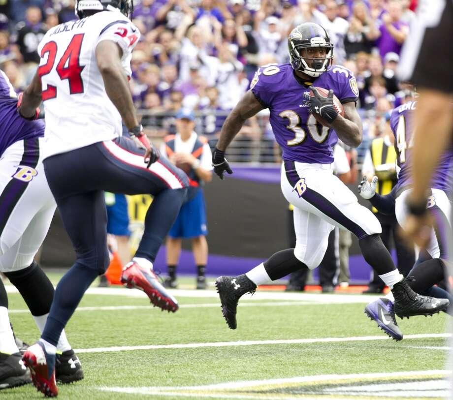 Bernard Pierce of the Ravens runs against the Texans. Photo: Brett Coomer, Houston Chronicle