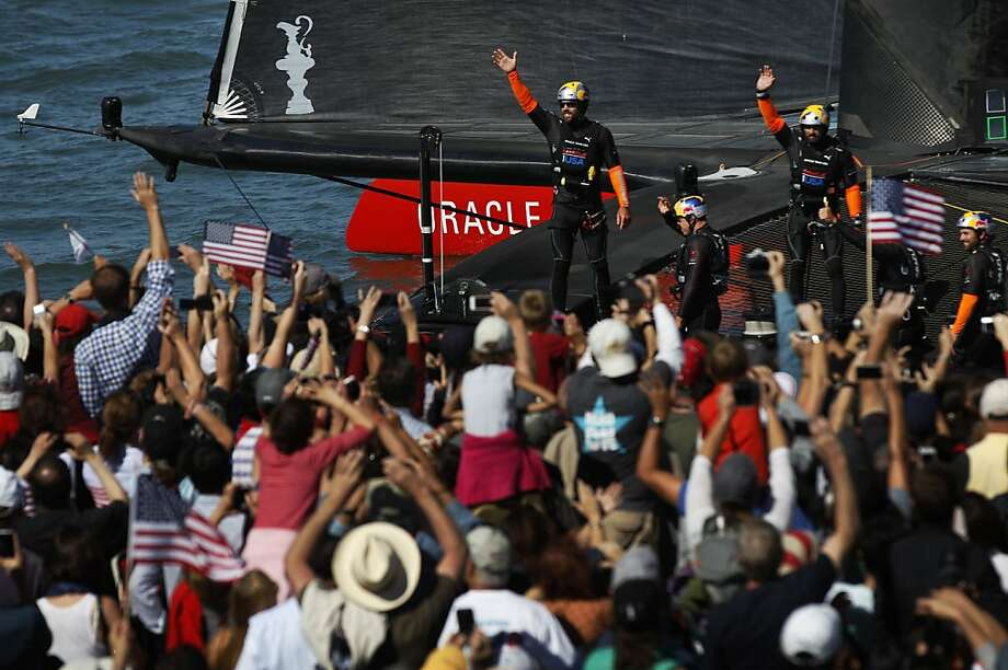 Oracle crew members and their fans exchange waves after two victories Sunday put the defending team back in contention for the America's Cup. Photo: Leah Millis, The Chronicle