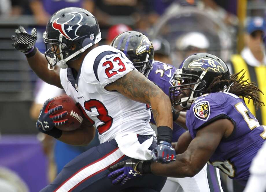 Ravens defenders wrap up Texans running back Arian Foster. Photo: Brett Coomer, Houston Chronicle