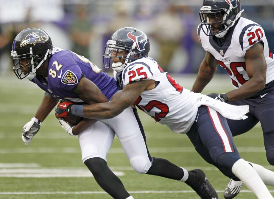 Texans cornerback Kareem Jackson tries to wrap up receiver Torrey Smith. Photo: Brett Coomer, Houston Chronicle