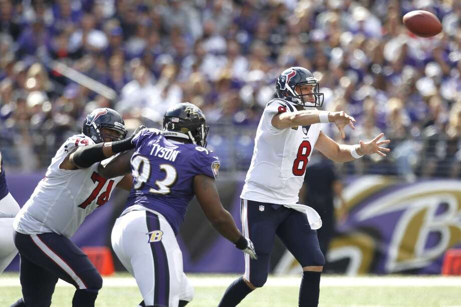 Texans quarterback Matt Schaub attempts a pass against the Ravens. Photo: Brett Coomer, Houston Chronicle