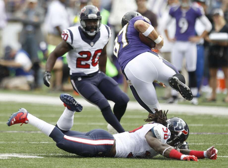 Texans safety D.J. Swearinger misses a tackle on Ravens tight end Dallas Clark. Photo: Brett Coomer, Houston Chronicle
