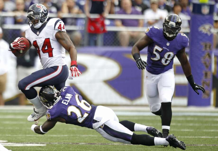 Texans running back Ben Tate is tripped by by a Ravens defender. Photo: Brett Coomer, Houston Chronicle