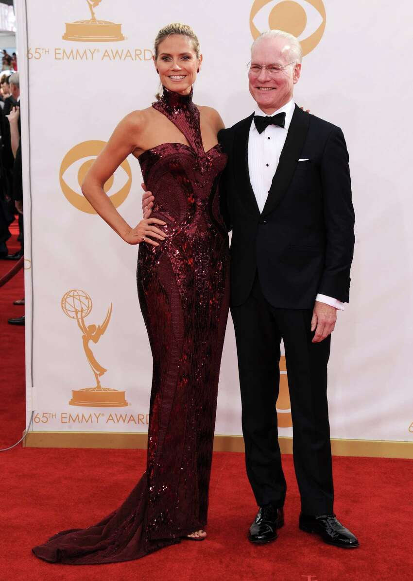 Heidi Klum, left, and Tim Gunn arrive at the 65th Primetime Emmy Awards at Nokia Theatre on Sunday Sept. 22, 2013, in Los Angeles. (Photo by Jordan Strauss/Invision/AP)