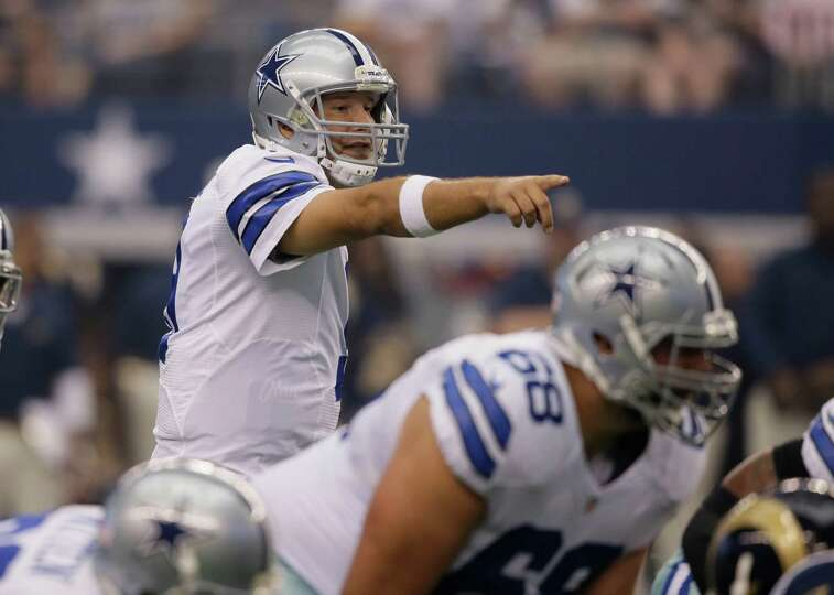 Dallas Cowboys quarterback Tony Romo (9) points from the line during the first quarter of a NFL foot