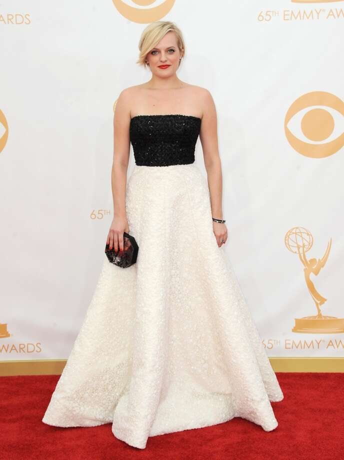 Elisabeth Moss arrives at the 65th Primetime Emmy Awards at Nokia Theatre on Sunday Sept. 22, 2013, in Los Angeles.  (Photo by Jordan Strauss/Invision/AP) Photo: Jordan Strauss, Associated Press
