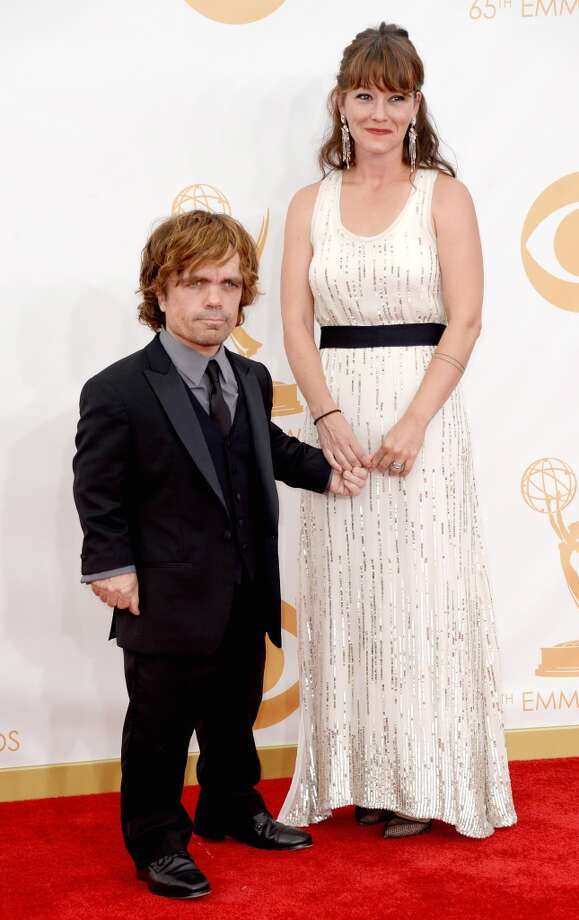 Actor Peter Dinklage and Erica Schmidt arrive at the 65th Annual Primetime Emmy Awards held at Nokia Theatre L.A. Live on September 22, 2013 in Los Angeles, California.  (Photo by Frazer Harrison/Getty Images) Photo: Frazer Harrison, Getty Images