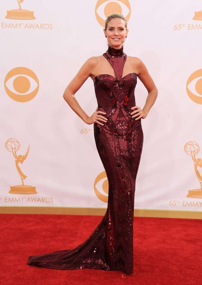 Heidi Klum, wearing Versace, arrives at the 65th Primetime Emmy Awards at Nokia Theatre on Sunday Sept. 22, 2013, in Los Angeles.  (Photo by Jordan Strauss/Invision/AP) Photo: Associated Press